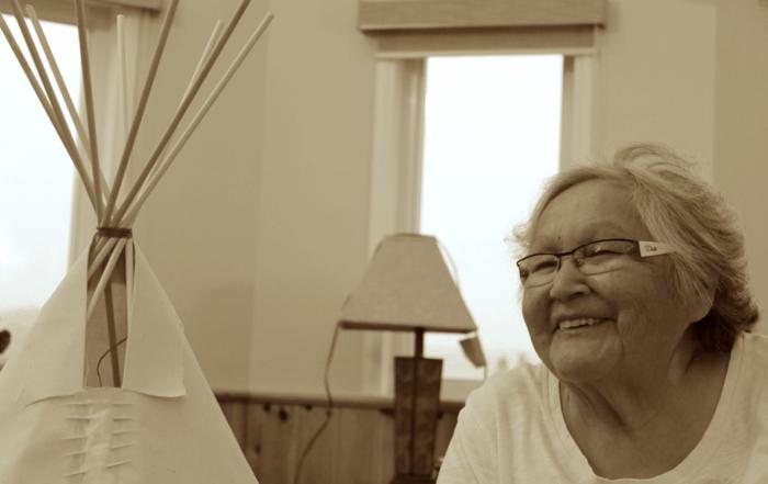 woman smiling near a teepee